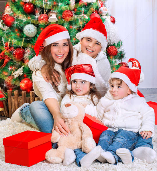 Happy family in Christmas eve Stock photo © Anna_Om