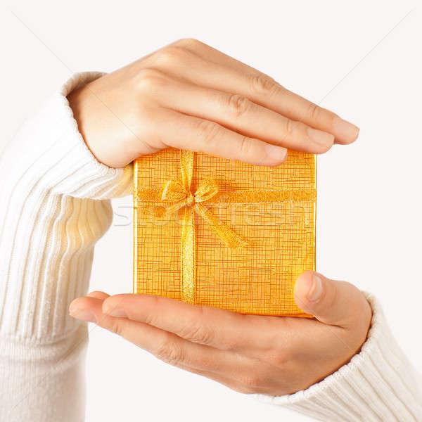 Golden gift in hands Stock photo © Anna_Om