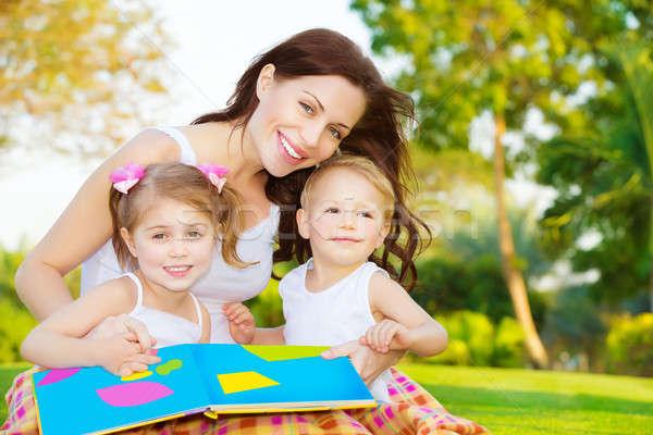 Happy family reading book Stock photo © Anna_Om