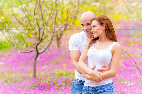 Stock photo: Lovers hugging outdoors