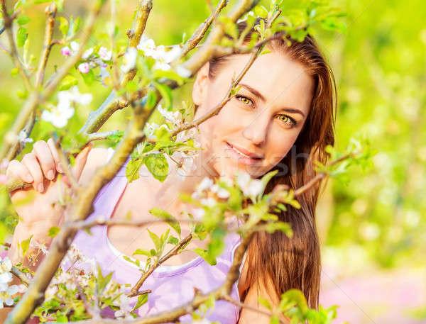 Csinos lány tavasz kert portré napos idő Stock fotó © Anna_Om