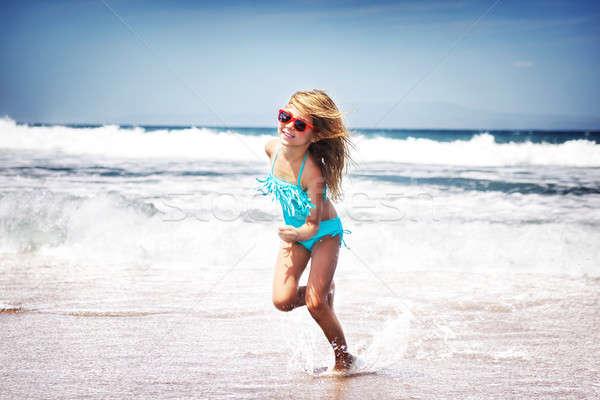 Baby girl running on a beach Stock photo © Anna_Om