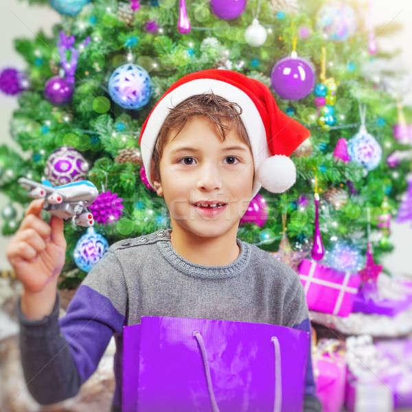 Happy boy near Christmas tree Stock photo © Anna_Om
