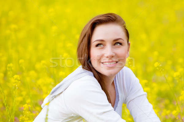 Stock photo: Woman on yellow floral field