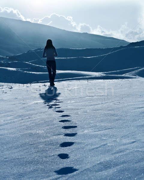 Yalnız kadın siluet kış dağlar ayak izleri Stok fotoğraf © Anna_Om