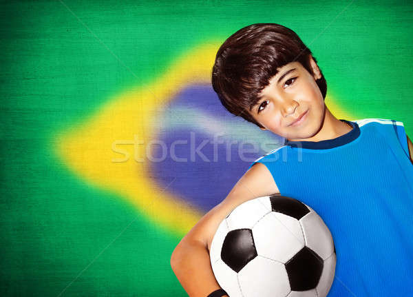 Cute boy playing football Stock photo © Anna_Om