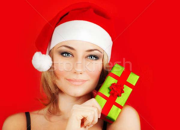 Happy Santa girl holding Christmas gift Stock photo © Anna_Om