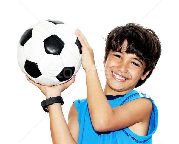 Stock photo: Cute boy playing football