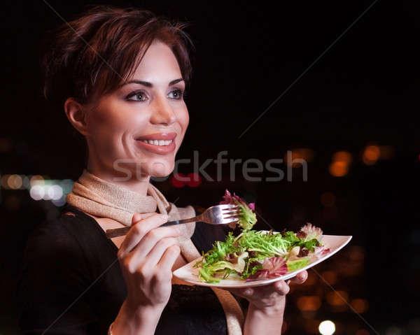 Mutlu kadın yeme salata şehir ışıkları Stok fotoğraf © Anna_Om