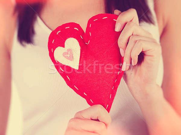 Piros szív nő tart kéz alakú Stock fotó © Anna_Om