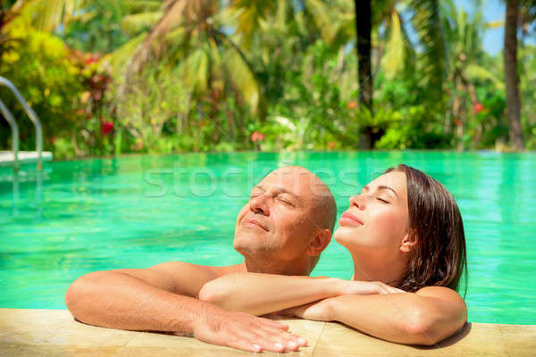 Romantic couple in a pool Stock photo © Anna_Om