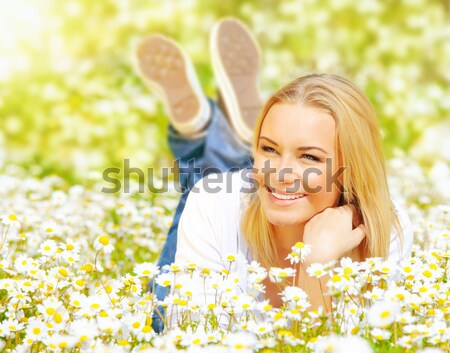 Beautiful female laying on the flower filed Stock photo © Anna_Om