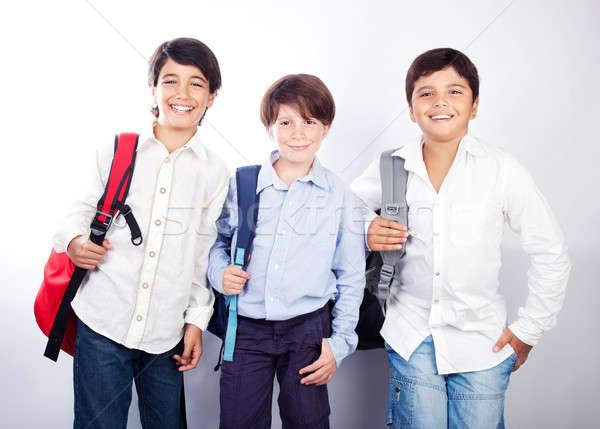 Three cheerful teenagers Stock photo © Anna_Om