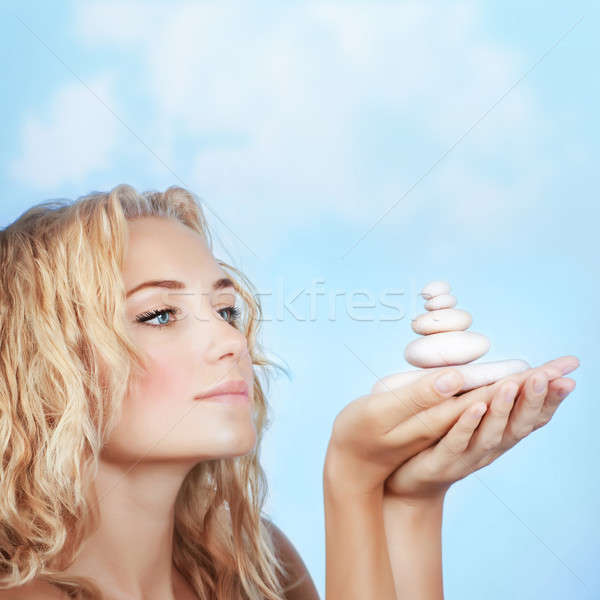 Pretty girl holding spa stones Stock photo © Anna_Om