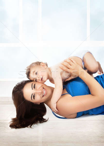 Joyful mother play with son Stock photo © Anna_Om