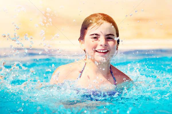 幸せな女の子 プール 肖像 笑みを浮かべて 女の子 演奏 ストックフォト © Anna_Om