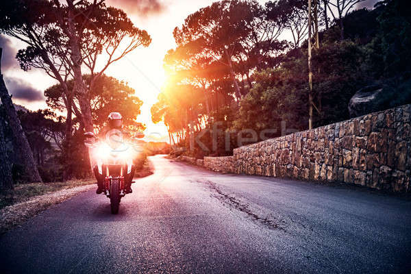 Motorcyclist in sunset light Stock photo © Anna_Om
