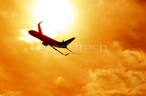 Airplane silhouette on sunset background Stock photo © Anna_Om