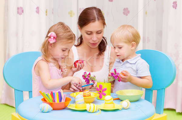 Mother with kids paint Easter eggs Stock photo © Anna_Om