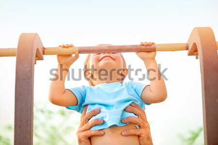 Little boy catch up on the horizontal  bar Stock photo © Anna_Om