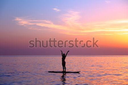 Doing yoga asanas on the beach Stock photo © Anna_Om