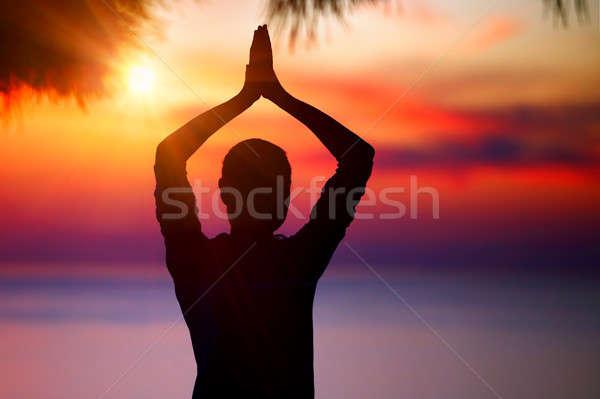 Yoga coucher du soleil silhouette femme coloré méditation Photo stock © Anna_Om