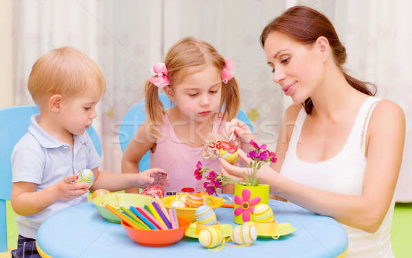Stock photo: Little kids with teacher painted Easter eggs