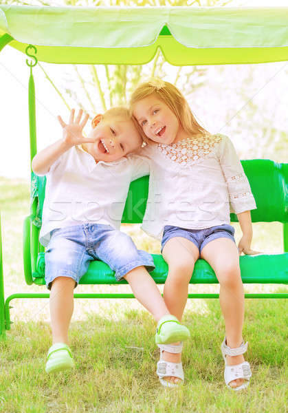 Brother and sister on the swing Stock photo © Anna_Om