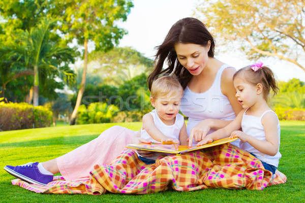 Mother teaching her kids Stock photo © Anna_Om