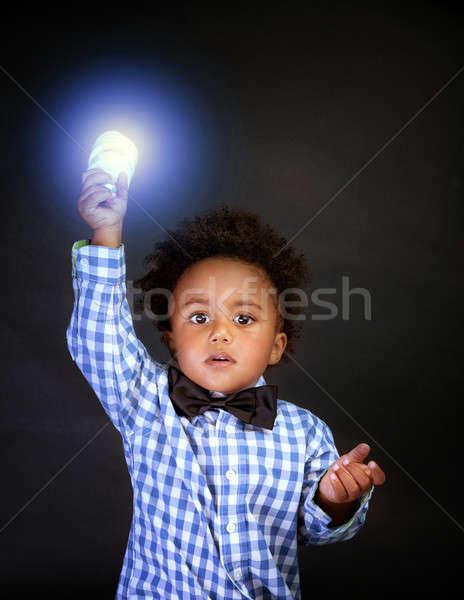 Weinig genie verlicht lamp hand geïsoleerd Stockfoto © Anna_Om