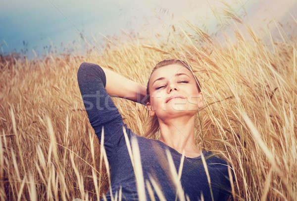 Cute girl on wheat field Stock photo © Anna_Om