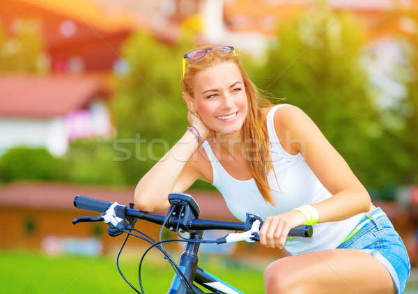 Happy woman on the bicycle Stock photo © Anna_Om