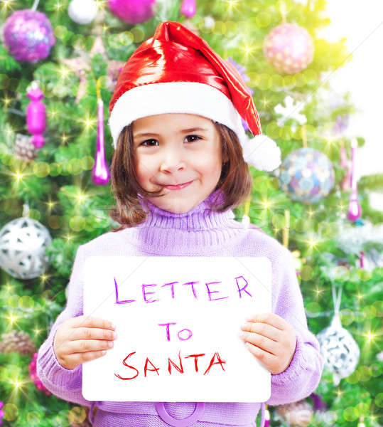 Little girl with letter to Santa Claus Stock photo © Anna_Om