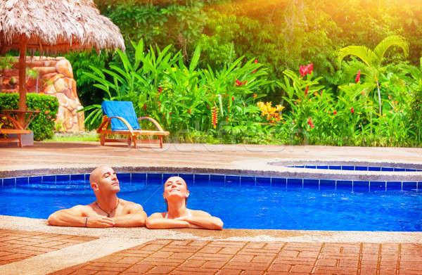 Gelukkig paar vakantie genieten zwembad jonge Stockfoto © Anna_Om