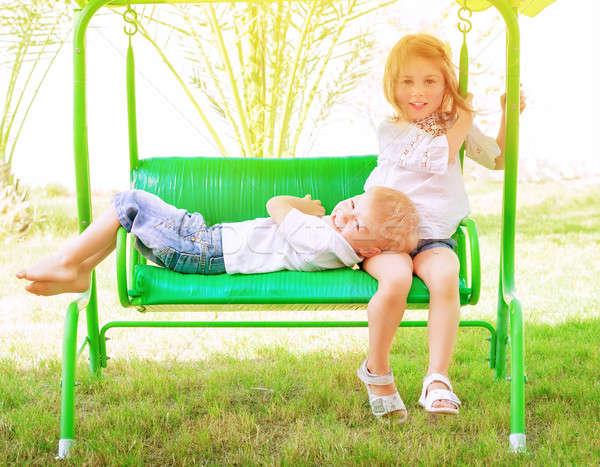 Zaman salıncak iki çok güzel çocuk Stok fotoğraf © Anna_Om