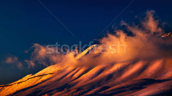 Stock photo: Beautiful sunset over snowy mountains