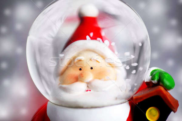 Stock photo: Santa Claus in the snow globe