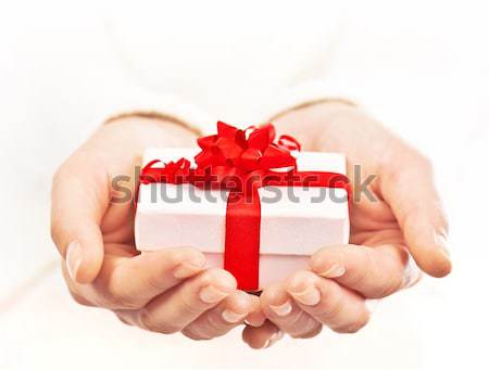 Hands holding beautiful gift box Stock photo © Anna_Om