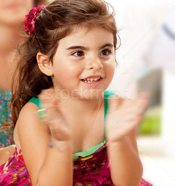 Stock photo: Little clapping baby girl