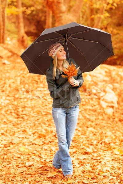 Csinos nő esernyő kép áll ősz erdő Stock fotó © Anna_Om