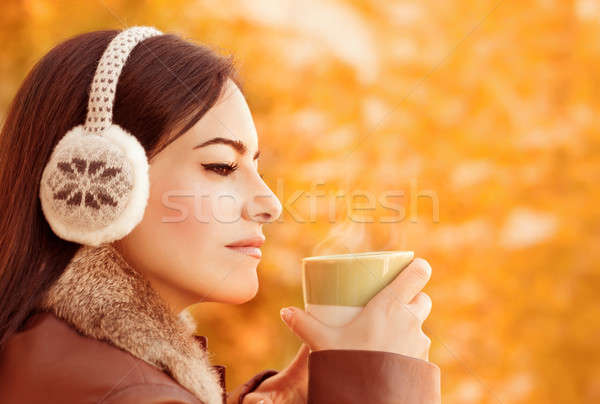 Female have coffee in autumn park Stock photo © Anna_Om