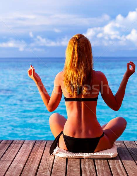Yoga exercise on seashore Stock photo © Anna_Om