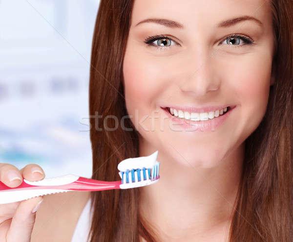 Woman brushing her teeth Stock photo © Anna_Om