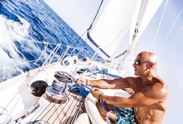 Stock photo: Handsome man working on sailboat