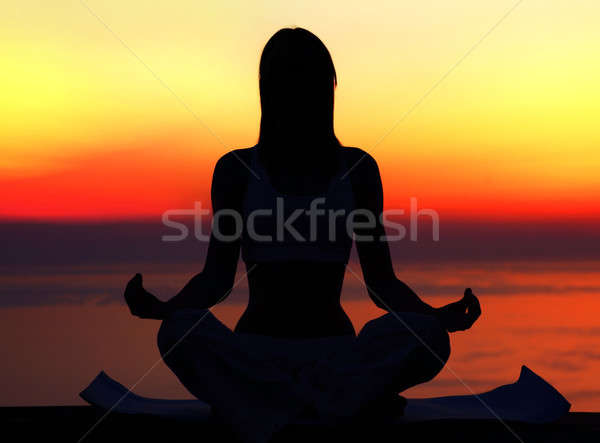 Stock photo: Yoga woman over sunset