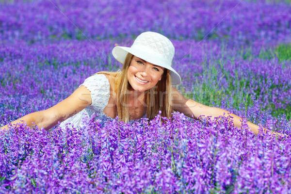Csinos nő levendula mező fekszik gyönyörű boldog női Stock fotó © Anna_Om
