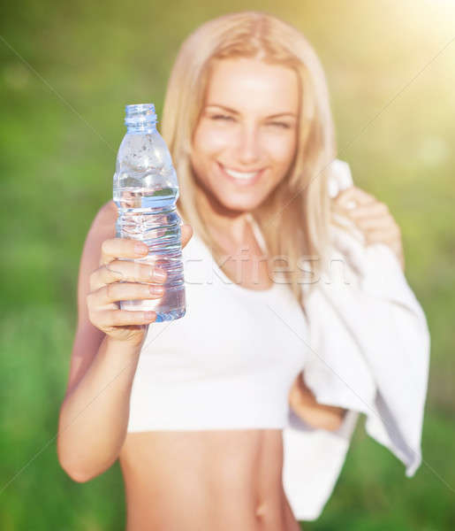 Sportive woman drinking water Stock photo © Anna_Om