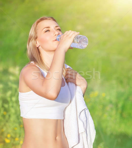 Happy woman drink water Stock photo © Anna_Om