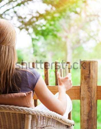 женщину расслабляющая терраса назад сторона Сток-фото © Anna_Om
