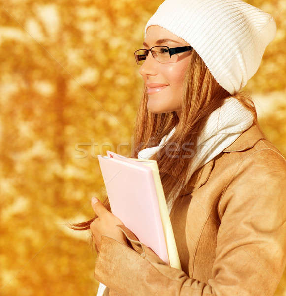 Smiling student girl in autumn Stock photo © Anna_Om